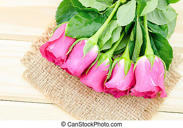 Pink roses on wooden.