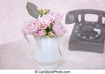 pink roses with retro telephone