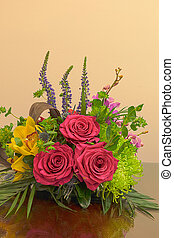 Pink roses, yellow cymbidium , green mums, and palms in a tropical bouquet