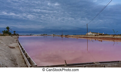 Pink salt pool in saltmine, wide angle timelapse at sunrise...