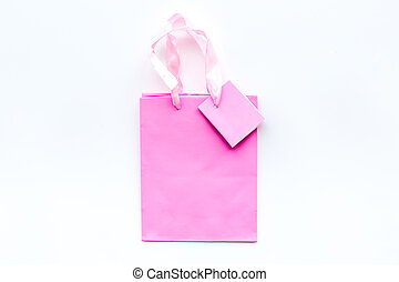 Pink shopping bag on white background top view copyspace