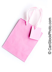 Pink shopping bag on white background top view mockup