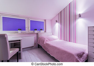 Pink single bedroom in apartment
