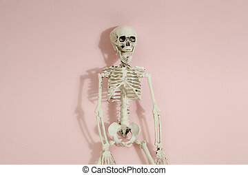 Pink skeleton - Isolated plastic toy skeleton a a vibrant...