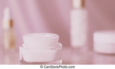 Pink skincare product line, face cream jar for healthy body care routine, organic cosmetic and beauty brand, stock footage