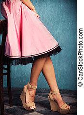 pink skirt and wedge high heel shoes