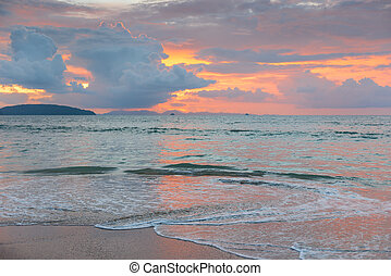 pink sky with beautiful clouds during sunset over the sea in Thailand