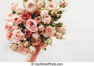 Pink small roses bouquet on white background isolated. Top view with space for text. Floral greeting card mockup. Wedding invitation, happy mother day or Valentine day concept.