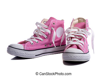 A pair of pink sneakers or basketball shoes on a white background