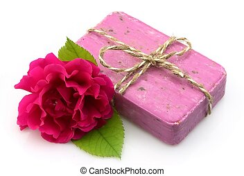 Pink soap with rose on white