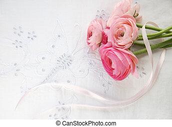 ranunculus flowers on decorative eyelet fabric