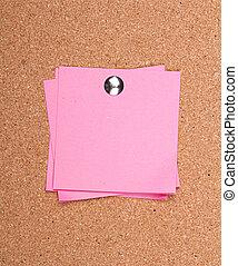 sticky note on a bulletin board