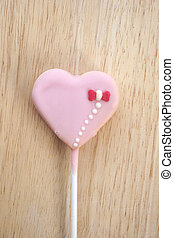 Pink strawberry candy on a stick in the form of heart