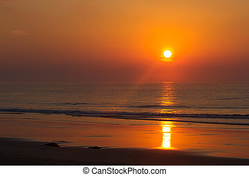 Pink sunset in ocean. India, Andaman island. Beach  with wave