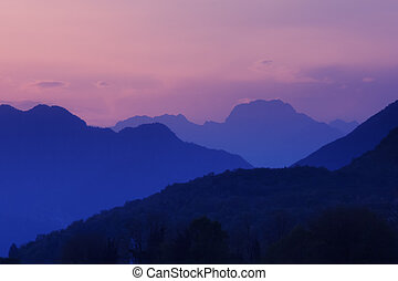 Pink sunset on the rocky mountains in Meduno