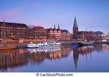 sunset over river in Bremen city