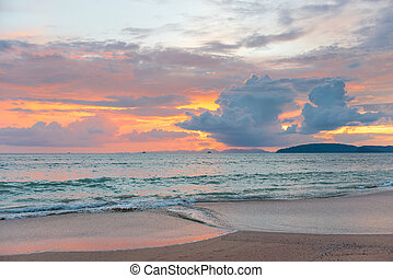 pink sunset over the sea, beautiful cumulus clouds in the sky