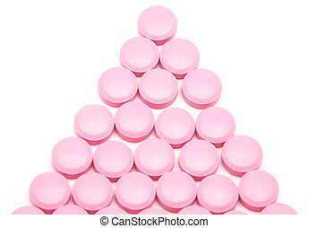 Pink tablets on a white background