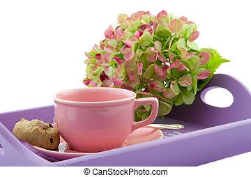 pink tea cup on purple tray