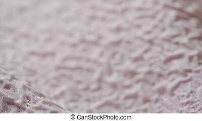 pink textile. Pastel pink crumpled cloth as background. -...