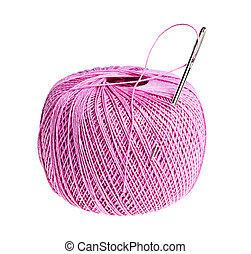 Pink thread ball and needle with thread isolated on white background