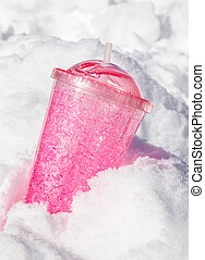 pink travel mug in snow. ice tumbler