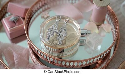 Pink tray with bridal earrings proposal ring and perfume...