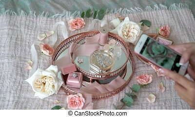 Pink tray with bridal earrings proposal ring and perfume -...