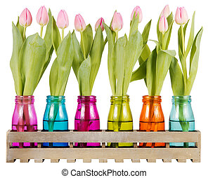 Pink tulips in colorful vases