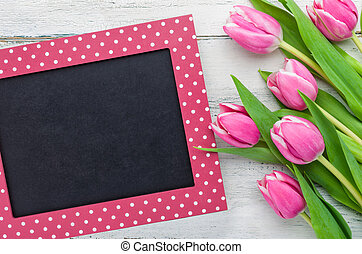 Pink Tulips on a white background with a blackboard