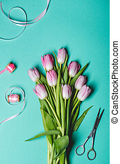 Pink tulips on blue background