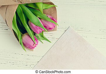 pink tulips on white shabby chic background with purple lilac sheet