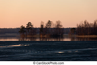 Pink twilight - Sunset on wood lake in the spring