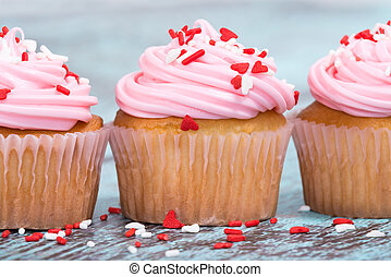 Pink Valentines Day cupcakes with sprinkles