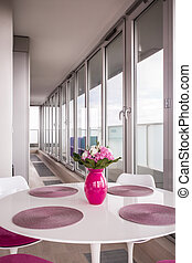 Pink vase on table