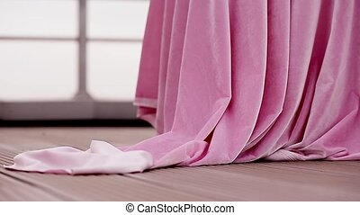 Pink velvet fabric fluttering in the wind. Close. Table cloth, curtain