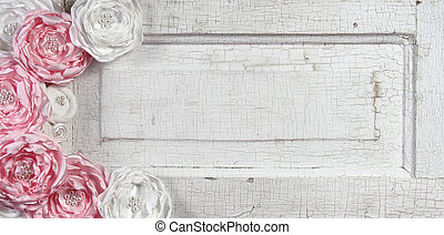 Pink vintage flowers on aged door