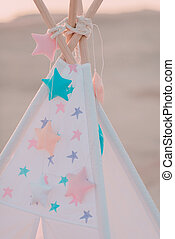 pink vintage wigwam with colorful stars