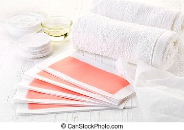 Pink waxing strips, cream and body oil