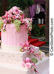 pink wedding cake with roses