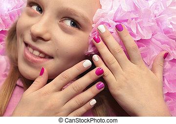 Pink white children's manicure.