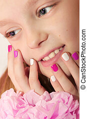 Pink white children's manicure.