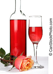 pink wine rose - pink wine bottle glass and rose on a table...