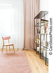 Pink wooden chair in interior