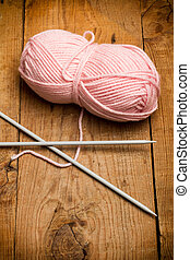 Pink wool and needles