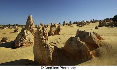 pinnacle desert sunlight - sunlight in the desert of...