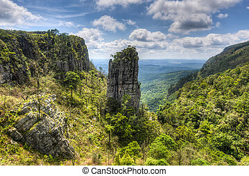 The Pinnacle Rock, a tower-like freestanding quartzite buttress which rises 30 m above the dense indigenous forest in Mpumalanga, South Africa.