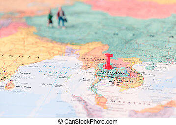 Pinned on map of Thailand and miniature travellers.