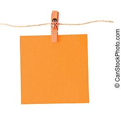 Pinned orange notepad isolated on white background
