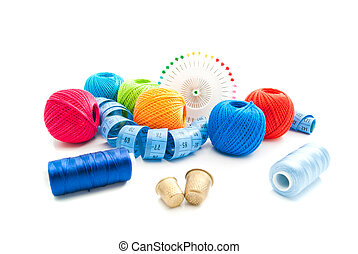 pins and other items for needlework on white